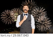 Купить «happy young man with fake mustache at party», фото № 29067043, снято 15 декабря 2017 г. (c) Syda Productions / Фотобанк Лори