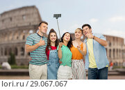 Купить «friends taking selfie by monopod over coliseum», фото № 29067067, снято 30 июня 2018 г. (c) Syda Productions / Фотобанк Лори