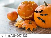 Купить «jack-o-lantern or carved halloween pumpkins», фото № 29067123, снято 15 сентября 2017 г. (c) Syda Productions / Фотобанк Лори