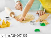 Купить «mother and daughter making cookies at home», фото № 29067135, снято 20 октября 2017 г. (c) Syda Productions / Фотобанк Лори