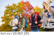 Купить «group of friends with backpacks hiking in autumn», фото № 29067255, снято 31 августа 2014 г. (c) Syda Productions / Фотобанк Лори