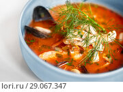Купить «close up of seafood soup with fish and mussels», фото № 29067347, снято 16 января 2017 г. (c) Syda Productions / Фотобанк Лори
