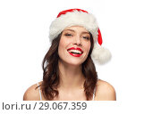 Купить «woman with red lipstick in santa hat at christmas», фото № 29067359, снято 5 января 2018 г. (c) Syda Productions / Фотобанк Лори