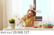 Купить «happy girl coloring easter eggs at home», видеоролик № 29068127, снято 10 августа 2018 г. (c) Syda Productions / Фотобанк Лори