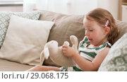Купить «baby girl playing with toy rabbit at home», видеоролик № 29068175, снято 10 августа 2018 г. (c) Syda Productions / Фотобанк Лори