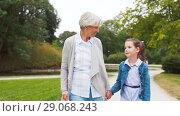 Купить «grandmother and granddaughter walking at park», видеоролик № 29068243, снято 27 августа 2018 г. (c) Syda Productions / Фотобанк Лори