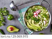Купить «Chicken Pozole Verde in a pot», фото № 29069915, снято 16 августа 2018 г. (c) Oksana Zh / Фотобанк Лори