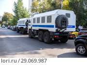Купить «Russian police heavy trucks parked on the city street in summer day», фото № 29069987, снято 9 сентября 2018 г. (c) FotograFF / Фотобанк Лори