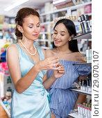 Купить «Girl and mother choosing decorative mascara in cosmetic shop», фото № 29070107, снято 21 июня 2018 г. (c) Яков Филимонов / Фотобанк Лори