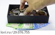 Купить «Take coins from a coin box with your hand. Russian rubles», видеоролик № 29076755, снято 24 июля 2019 г. (c) Леонид Еремейчук / Фотобанк Лори