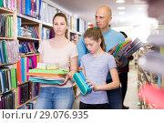 Купить «parents and child choosing school stationery», фото № 29076935, снято 6 апреля 2018 г. (c) Яков Филимонов / Фотобанк Лори