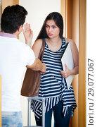 Frustrated man watching wife leaving him. Стоковое фото, фотограф Яков Филимонов / Фотобанк Лори