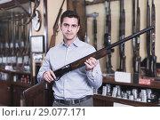 Adult man owner of shop standing with shotgun. Стоковое фото, фотограф Яков Филимонов / Фотобанк Лори