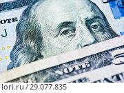Купить «Деньги. Фрагменты долларовых банкнот США крупным планом», фото № 29077835, снято 11 августа 2018 г. (c) Екатерина Овсянникова / Фотобанк Лори
