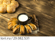 Купить «Food. Baking of confectionery. Fresh baked bakery roll with poppy seeds and sesame seeds with a cup of milk for breakfast on the background of the texture of a wooden table», фото № 29082531, снято 25 августа 2018 г. (c) Светлана Евграфова / Фотобанк Лори