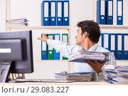 Купить «Overloaded busy employee with too much work and paperwork», фото № 29083227, снято 7 июля 2018 г. (c) Elnur / Фотобанк Лори