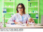 Купить «Woman dentist working on teeth implant», фото № 29083459, снято 11 июня 2018 г. (c) Elnur / Фотобанк Лори