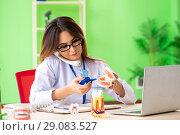 Купить «Woman dentist working on teeth implant», фото № 29083527, снято 11 июня 2018 г. (c) Elnur / Фотобанк Лори