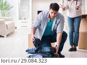 Купить «Woman evicting man from house during family conflict», фото № 29084323, снято 23 марта 2018 г. (c) Elnur / Фотобанк Лори