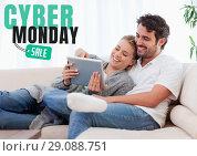 Купить «Cyber Monday Sale Man and Woman sitting on a couch with their tablet», фото № 29088751, снято 27 января 2020 г. (c) Wavebreak Media / Фотобанк Лори