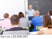 Купить «Elderly teacher standing in front of students», фото № 29090967, снято 28 июня 2018 г. (c) Яков Филимонов / Фотобанк Лори