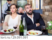 Купить «Quarreled visitors female and male in restaurant», фото № 29091091, снято 11 декабря 2017 г. (c) Яков Филимонов / Фотобанк Лори