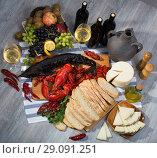 Купить «Top view of smoked sturgeon, crustaceans, fruits and wine», фото № 29091251, снято 10 февраля 2018 г. (c) Яков Филимонов / Фотобанк Лори