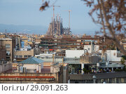 Купить «Barcelona roofs against background of Sagrada Familia», фото № 29091263, снято 2 июня 2017 г. (c) Яков Филимонов / Фотобанк Лори