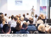 Купить «Business speaker giving a talk at business conference event.», фото № 29092455, снято 15 июня 2018 г. (c) Matej Kastelic / Фотобанк Лори