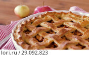 close up of apple pie and knife on wooden table. Стоковое видео, видеограф Syda Productions / Фотобанк Лори
