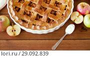 Купить «close up of apple pie on wooden table», видеоролик № 29092839, снято 7 сентября 2018 г. (c) Syda Productions / Фотобанк Лори
