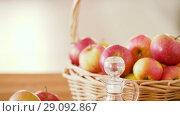 Купить «apples in basket and jug of juice on table», видеоролик № 29092867, снято 7 сентября 2018 г. (c) Syda Productions / Фотобанк Лори