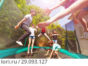 Купить «Boys and girls playing on the outdoor trampoline», фото № 29093127, снято 20 мая 2018 г. (c) Сергей Новиков / Фотобанк Лори