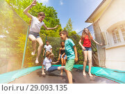 Купить «Happy children jumping on the outdoor trampoline», фото № 29093135, снято 20 мая 2018 г. (c) Сергей Новиков / Фотобанк Лори