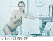 Купить «smiling girl in underpants in the office», фото № 29093551, снято 24 апреля 2017 г. (c) Яков Филимонов / Фотобанк Лори