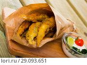 Купить «Fish and chips with creamy cheese sauce», фото № 29093651, снято 23 августа 2018 г. (c) Яков Филимонов / Фотобанк Лори