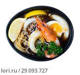 Купить «Image of spicy pan-Asian soup with squid, shrimp, egg noodles and sesame», фото № 29093727, снято 16 января 2019 г. (c) Яков Филимонов / Фотобанк Лори
