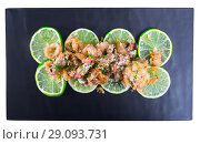 Купить «Top view of squid and cuttlefish tempura with lime», фото № 29093731, снято 17 октября 2018 г. (c) Яков Филимонов / Фотобанк Лори