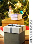Купить «Gift boxes with bows on the lids under a Christmas tree in New Year Eve», фото № 29099343, снято 1 января 2018 г. (c) Георгий Дзюра / Фотобанк Лори