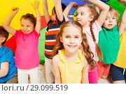 Купить «Children playing parachute during sports festival», фото № 29099519, снято 15 апреля 2017 г. (c) Сергей Новиков / Фотобанк Лори