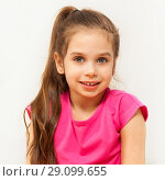 Купить «Portrait of smiling brunette seven years old girl», фото № 29099655, снято 15 апреля 2017 г. (c) Сергей Новиков / Фотобанк Лори