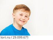 Купить «Portrait of seven years old boy in blue t-shirt», фото № 29099671, снято 15 апреля 2017 г. (c) Сергей Новиков / Фотобанк Лори