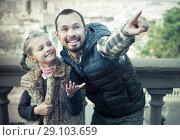 Купить «Father and daughter walking in city», фото № 29103659, снято 22 сентября 2018 г. (c) Яков Филимонов / Фотобанк Лори