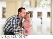 Купить «Father and daughter exploring paintings in museum», фото № 29103671, снято 22 сентября 2018 г. (c) Яков Филимонов / Фотобанк Лори