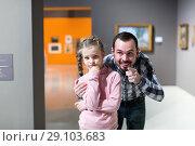 Купить «Male and small girl looking paintings in museum», фото № 29103683, снято 22 сентября 2018 г. (c) Яков Филимонов / Фотобанк Лори