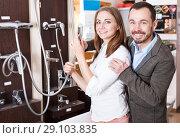 Купить «Couple choosing new shower mixer in store», фото № 29103835, снято 11 апреля 2018 г. (c) Яков Филимонов / Фотобанк Лори