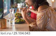 female friends eating at restaurant. Стоковое видео, видеограф Syda Productions / Фотобанк Лори