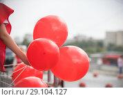 Купить «young woman holding in her hands red baloons on the street», фото № 29104127, снято 1 сентября 2018 г. (c) Константин Шишкин / Фотобанк Лори