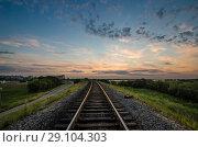 Купить «Железная дорога на насыпи на фоне заката», фото № 29104303, снято 23 июля 2018 г. (c) Яковлев Сергей / Фотобанк Лори