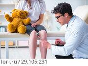 Купить «Doctor checking up young girls reflexes with hammer», фото № 29105231, снято 6 марта 2018 г. (c) Elnur / Фотобанк Лори